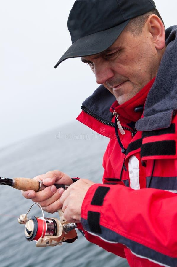 Bobine d'enroulement de pêcheur photo stock