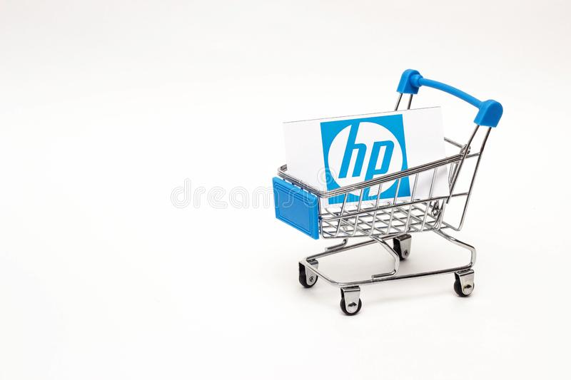BOBRUISK, BELARUS - JANUARY 30, 2019: Shopping cart on a white background in which the business card of the corporation stock image