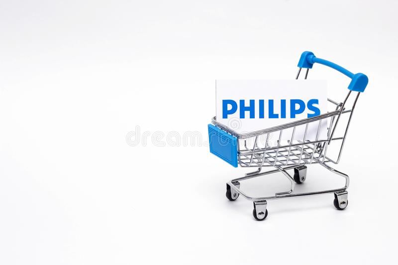 BOBRUISK, BELARUS - JANUARY 30, 2019: Shopping cart on a white background in which the business card of the corporation royalty free stock photography