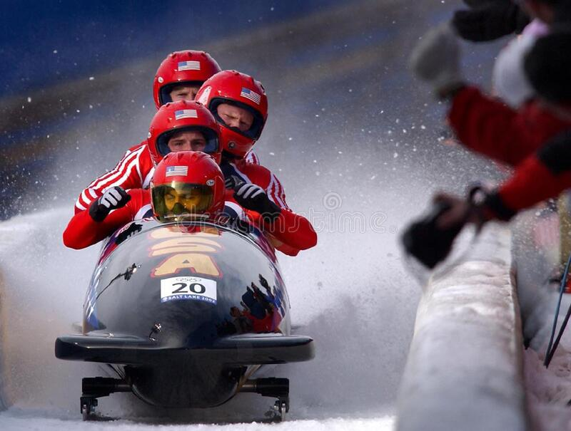 Bobsled team on course stock photo