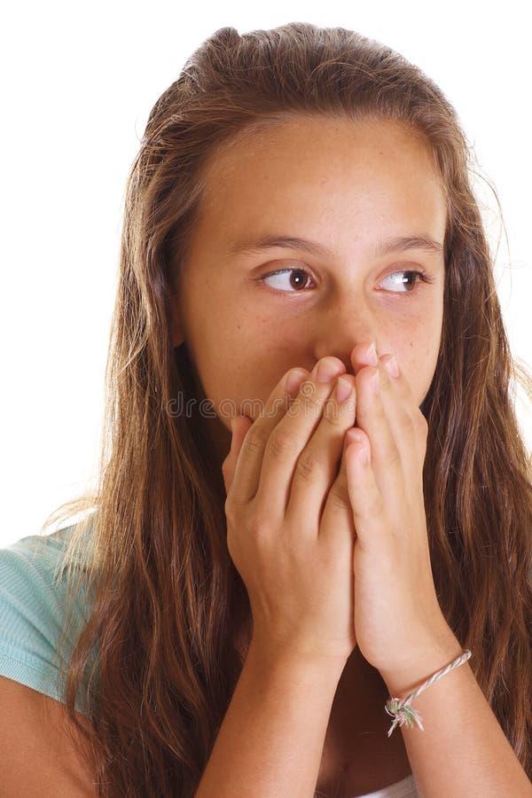 Boca adolescente da coberta da menina imagem de stock