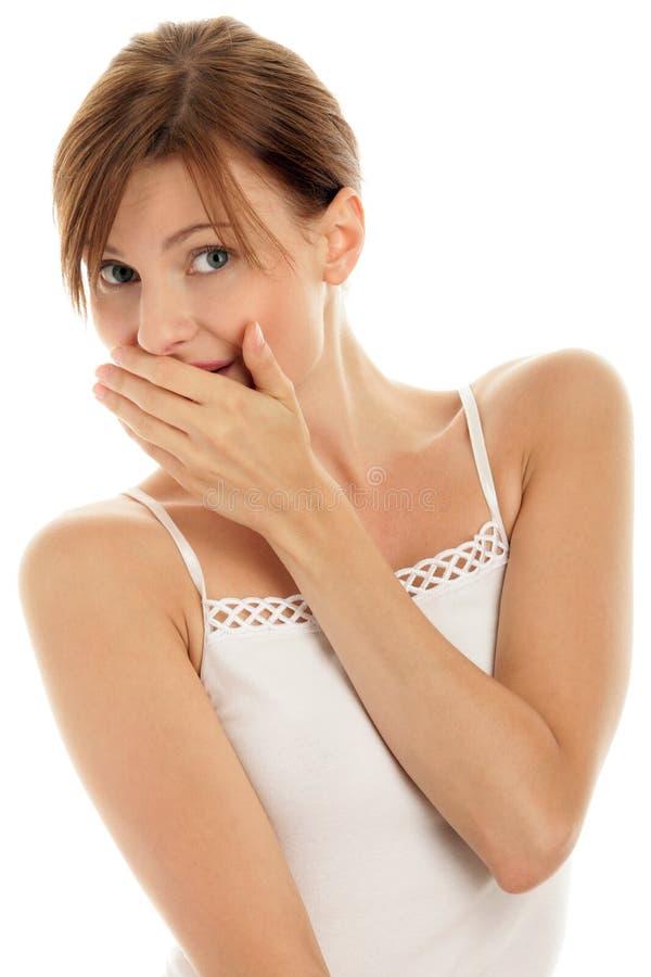 Boca da coberta da mulher fotos de stock