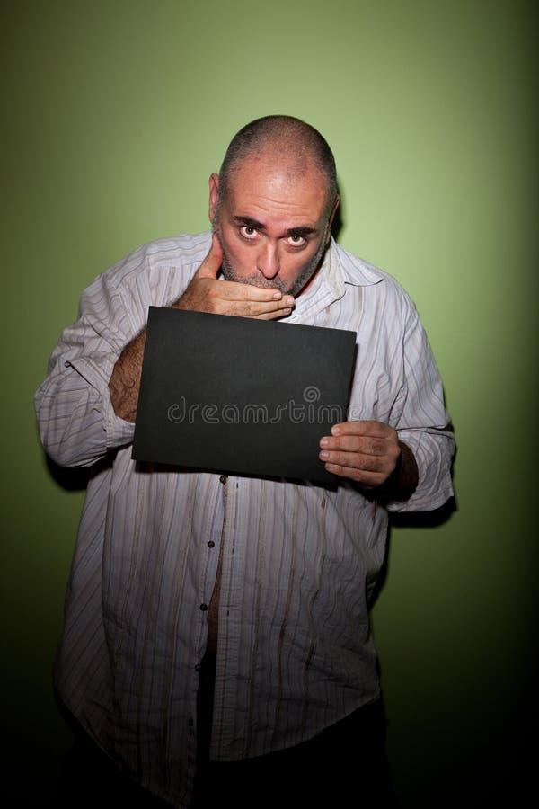 Boca de la cubierta del hombre en mugshot fotografía de archivo libre de regalías