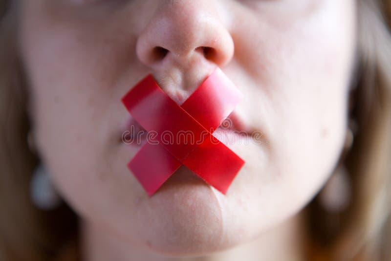 A boca do ½ s do ¿ do girlï é selada com fita imagem de stock royalty free