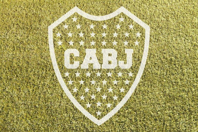 Boca Junior-Emblem auf Gras stockbild