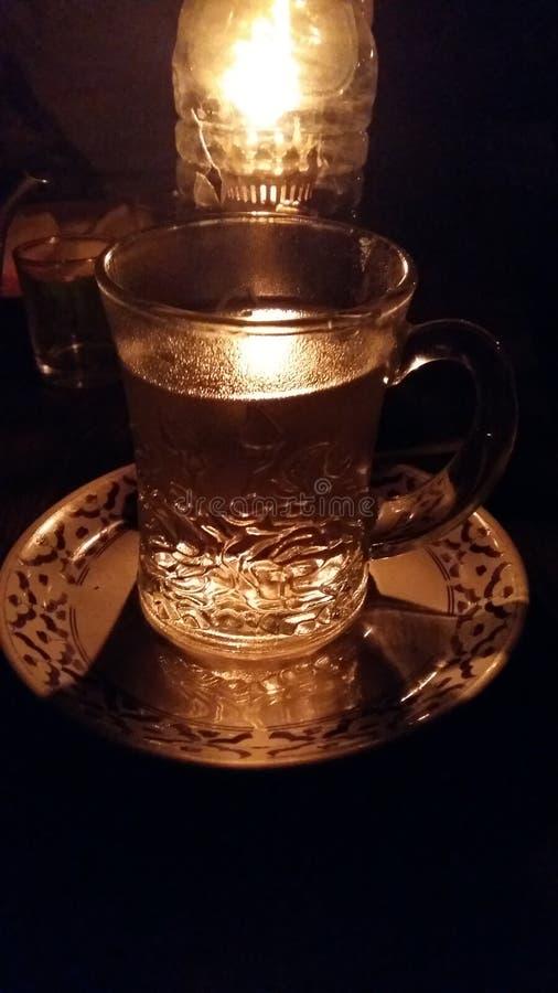 Boca Light Lantern, Dark Glass, Wood Table, Night stock photography