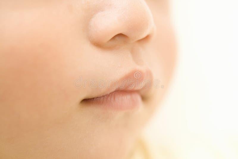 Boca minúscula do bebê foto de stock