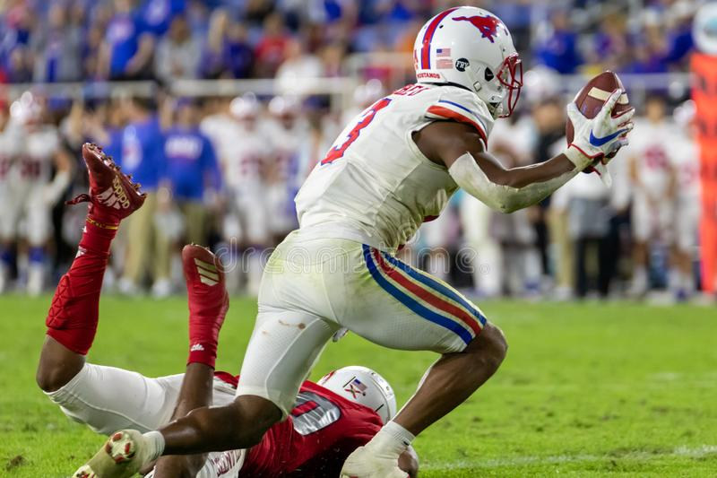 Florida Atlantic Owls vs SMU Mustangs. Cheribundi Boca Raton Bowl 2019. College Football players on the field in attack at FAU Foo. Boca Raton, Florida/USA stock photography
