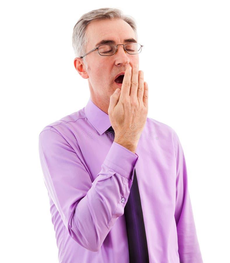 Boca sonolento da coberta do homem de negócios e bocejo imagens de stock