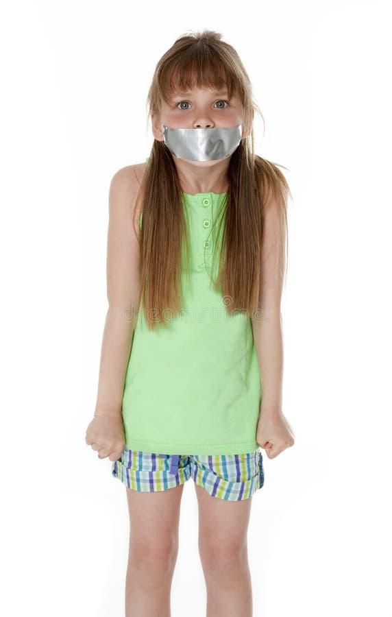 Boca sujetada con cinta adhesiva cerrada foto de archivo libre de regalías