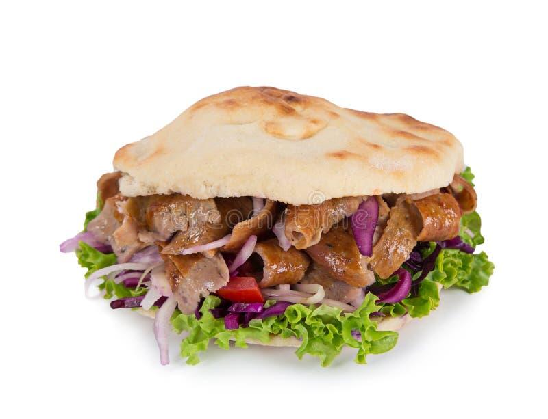 Bocadillo del kebab de Doner del turco en el fondo blanco imágenes de archivo libres de regalías