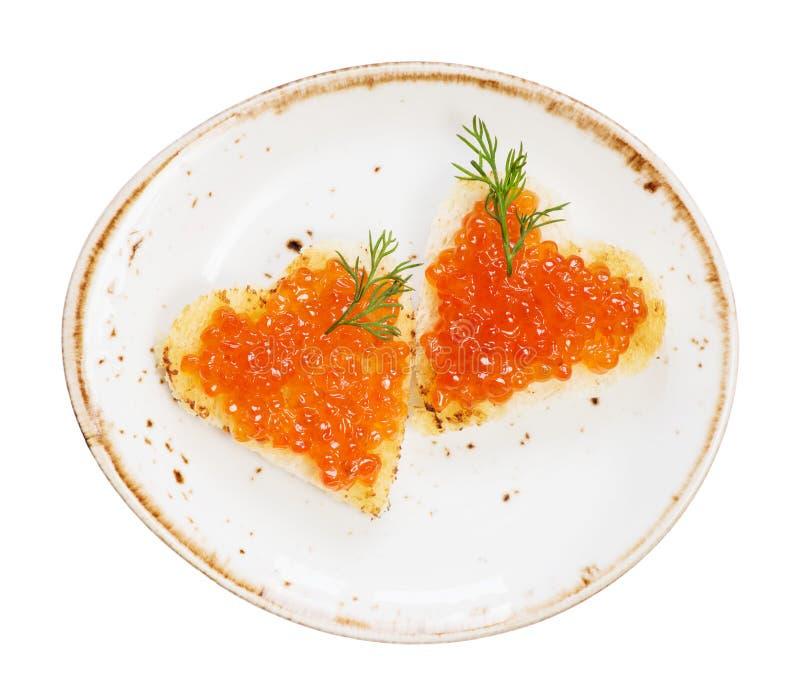 Bocadillos con el caviar rojo fotos de archivo
