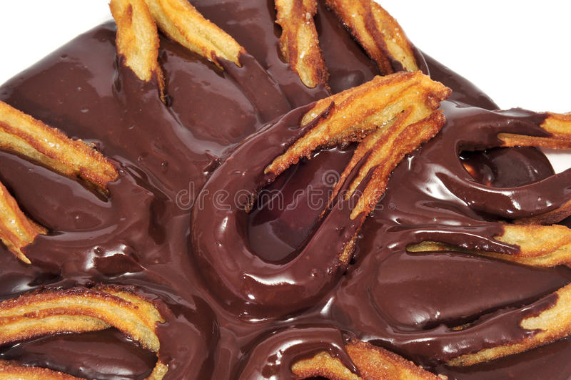 Bocado dulce español típico del chocolate de la estafa de Churros imagen de archivo