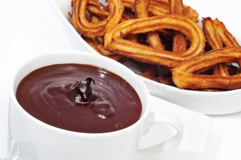 Bocado dulce español típico del chocolate de la estafa de Churros imágenes de archivo libres de regalías