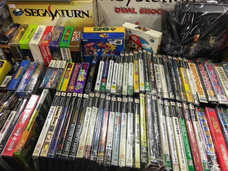 Bocado retro Playstation do sistema Sega Saturn 16 do jogo 2 cartuchos de jogo fotos de stock
