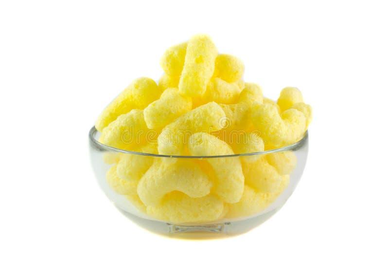 Bocados del maíz del queso imagen de archivo