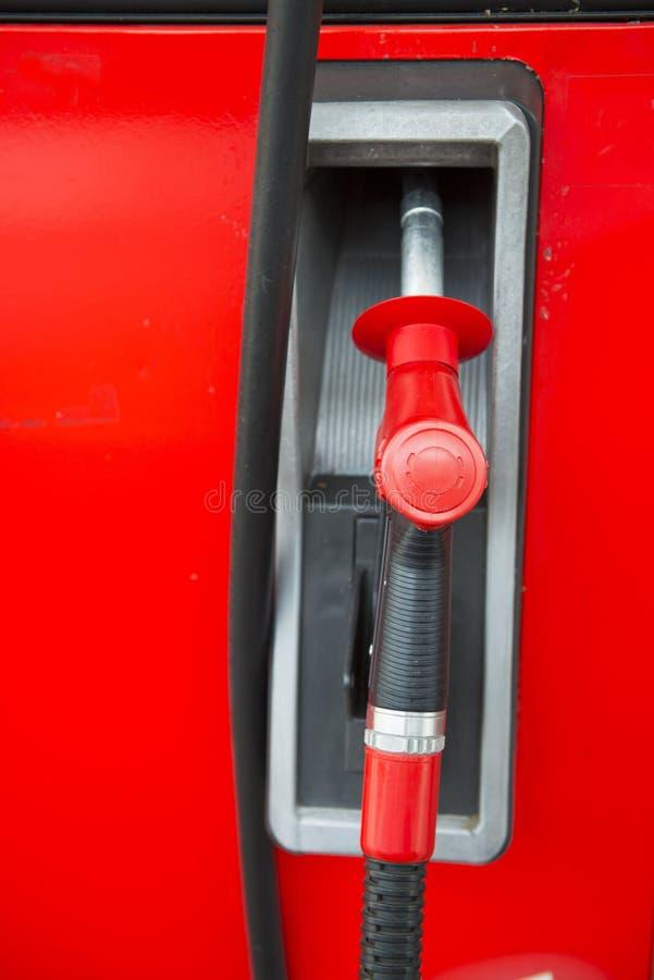 Bocal de combustível vermelho no posto de gasolina fotografia de stock royalty free