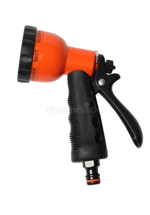 Bocal funcional em uma mangueira para a arma de pulverizador molhando do chuveiro isolada sobre o fundo branco fotografia de stock