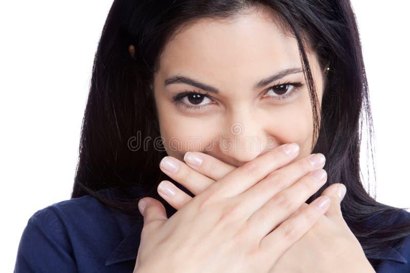 Bocca felice della copertura della giovane donna immagine stock
