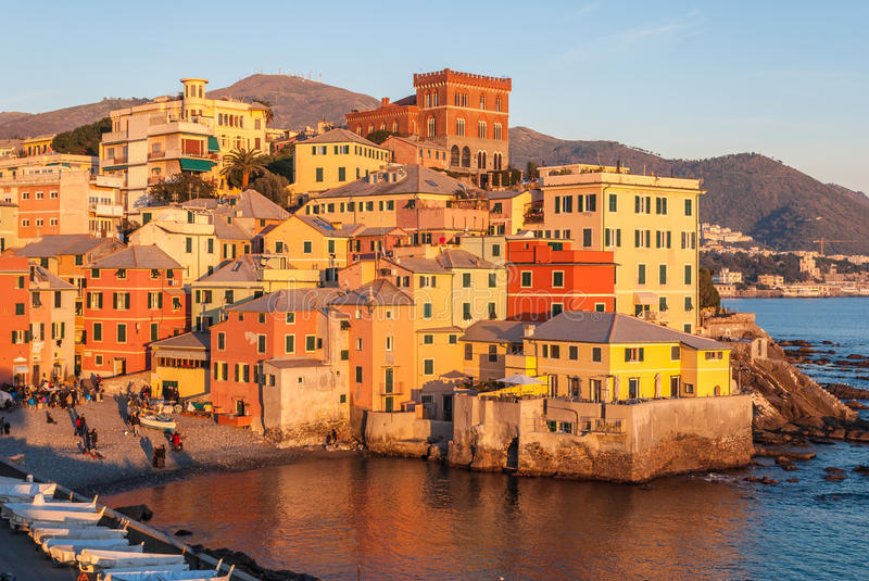 Boccadasse, a small sea district of Genoa, during the golden hour stock photography