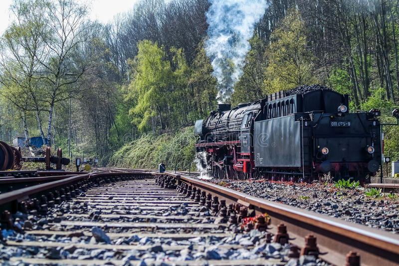 Bochum , Germany - April 18 2015 : Steam train passing the station in Dahlhausen. BOCHUM , GERMANY - APRIL 18 2015 : Steam train passing the station in Bochum stock image