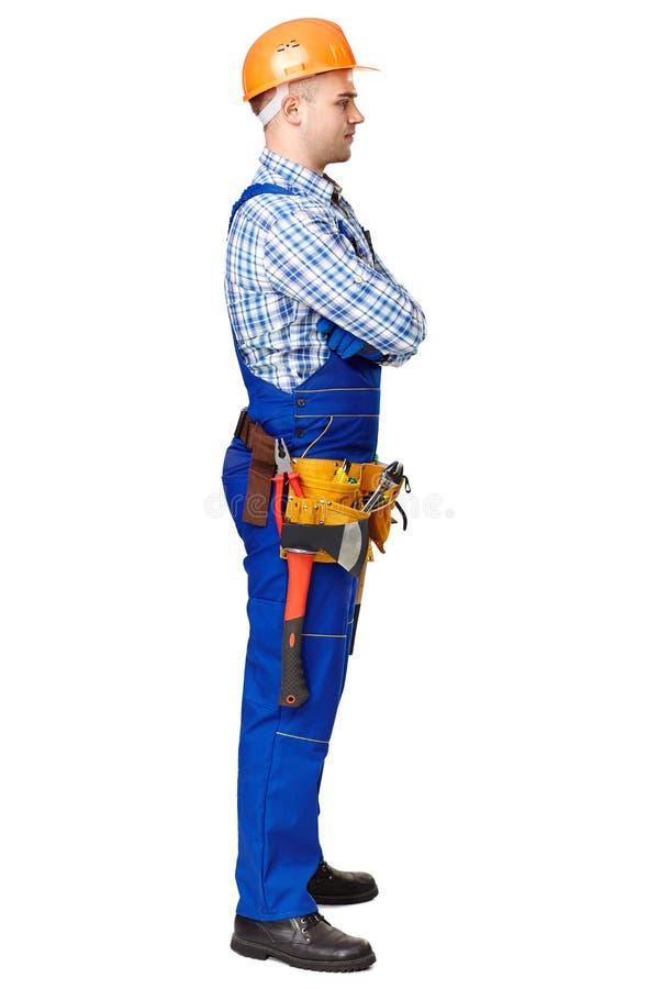 Bocznego widoku portret młody męski pracownik budowlany obraz stock