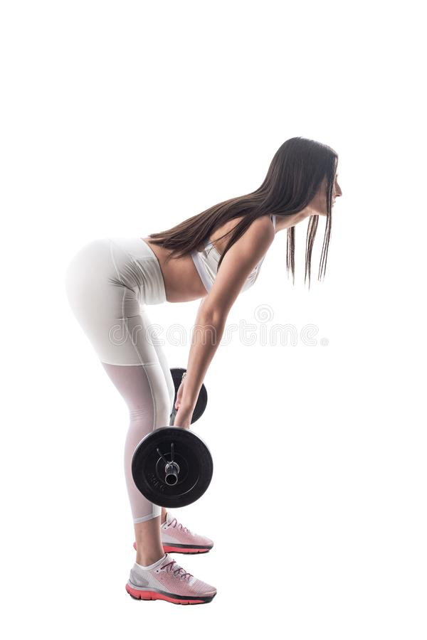 Boczny widok chylenie sprawności fizycznej kobieta robi nad barbell deadlift ćwiczeniem zdjęcia royalty free