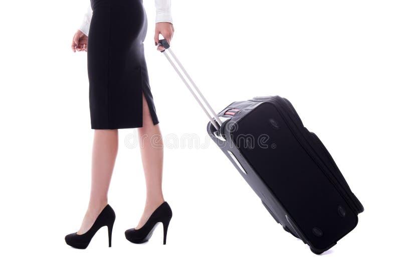 Boczny widok stewardesy odprowadzenie z walizką odizolowywającą na bielu fotografia royalty free