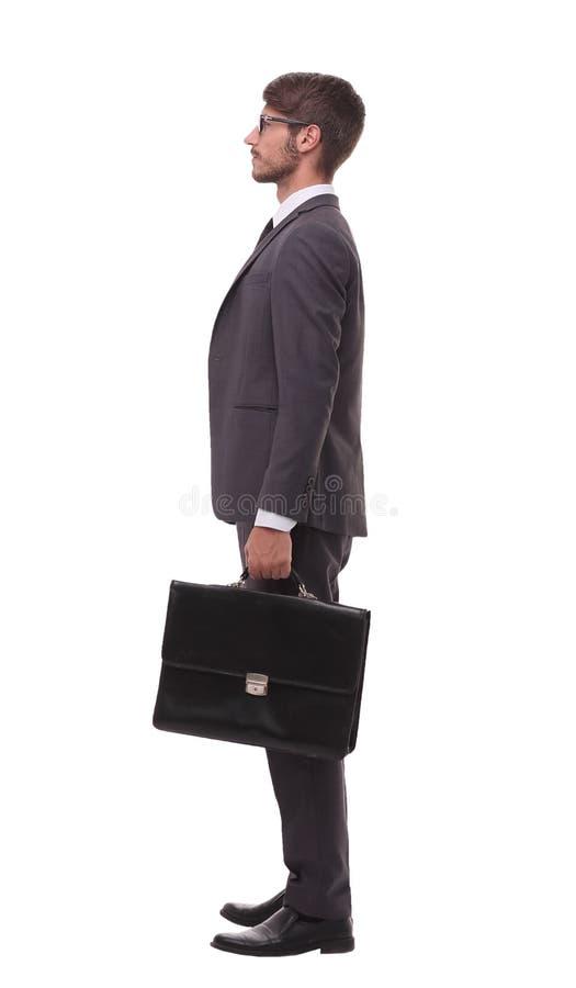 Boczny widok ufny biznesmen z rzemienną teczką zdjęcie royalty free