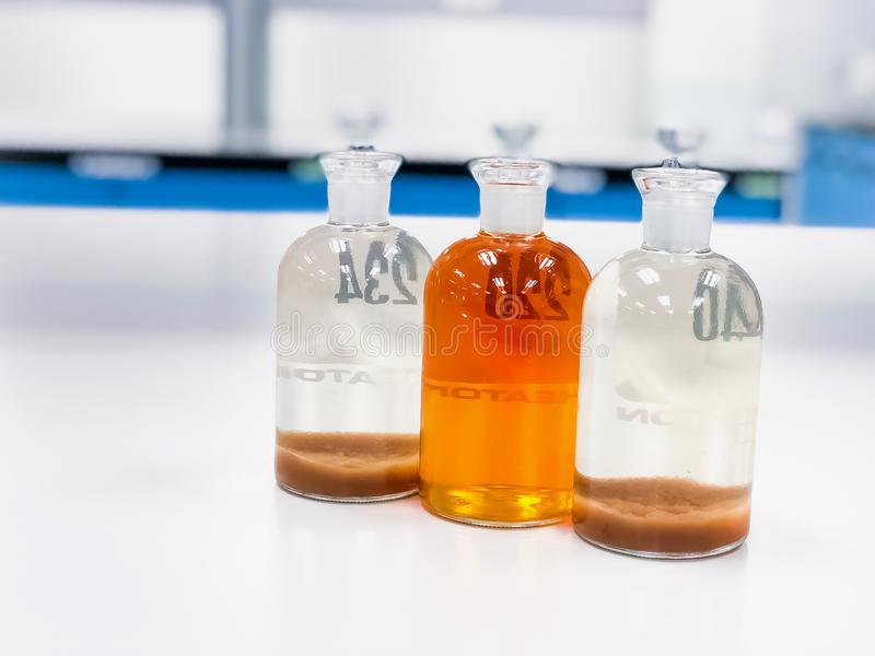 BOD bottle use for analysis dissolve oxygen in waste water sample then titration with solution to give clear solvent. royalty free stock photo