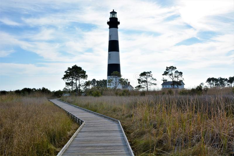 The Bodie Island Lighthouse is an easly recognized structure along the coast of the Outer Banks in North Carolina. The Bodie Island Lighthouse was rebuilt in stock photos