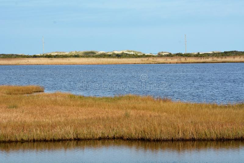 The Bodie Island Lighthouse landscape looking toward the beach. The current Bodie Island Lighthouse is the third that has stood in this vicinity of Bodie Island royalty free stock images