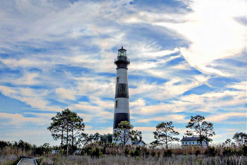 The Bodie Island Lighthouse is surrounded by an expansive marsh habitat. The Bodie Island Lighthouse was rebuilt in 1872 after being destroyed in 1862 by stock images