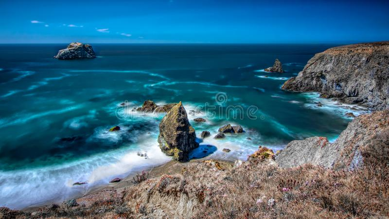 Bodega Bay coastline on a sunny day with blue cloudless sky royalty free stock images