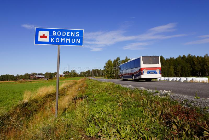 Bus enters Boden municipality. Boden, Sweden - August 21, 2019. One public transportation bus passing the Boden municipality border road sign royalty free stock photos