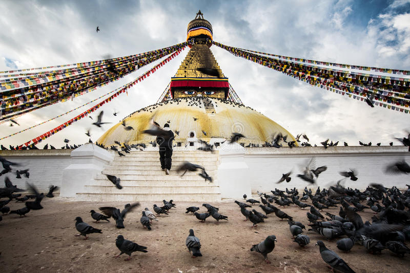 Bodhnath stupa with flying birds and people hope at blue sky in Kathmandu valley, Nepal.  stock images