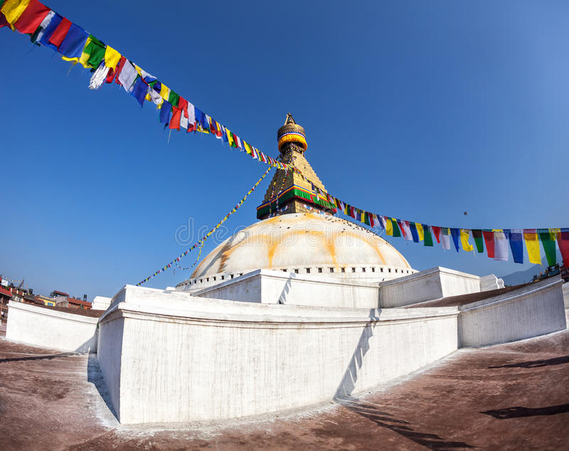 Bodhnath stupa with prayer flags. Bodhnath stupa with colorful prayer flags at blue sky in Kathmandu valley, Nepal royalty free stock photos
