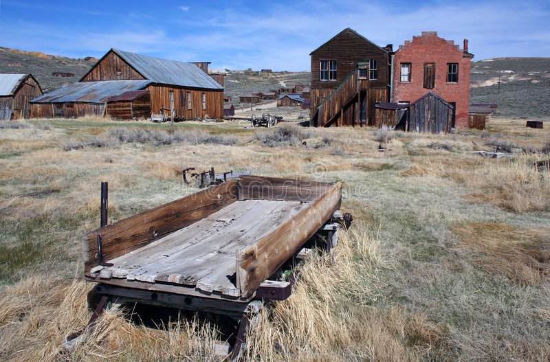 Bodie Ghost Town. Wagon and old historical buildings from the wild west town of Bodie, California stock photo