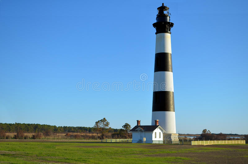 Bodie Island Lighthouse. Bodie (pronounced body) Island Light on the North Carolina Outer Banks. This light has fresh paint and is in beautiful condition royalty free stock photos