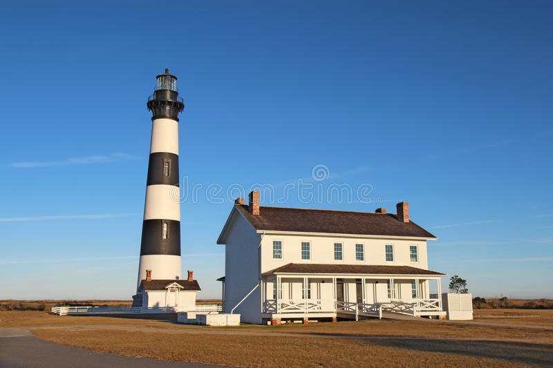 The Bodie Island lighthouse on the Outer Banks of North Carolina. The Bodie Island lighthouse and keeper's quarters at the Cape Hatteras National Seashore stock image