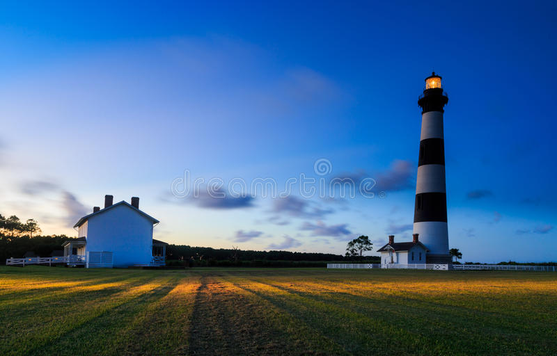 Bodie Island Lighthouse sunset in Nag's Head NC. Bodie Island Lighthouse at sunset South Nag's Head NC. Summertime view facing east. Lighthouse is newly stock photography