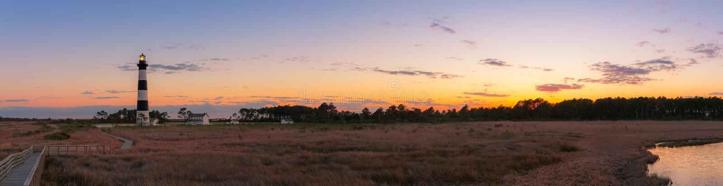Bodie Island Lighthouse sunset panorama. Panorama of Bodie Island Lighthouse and the surrounding marsh royalty free stock photography