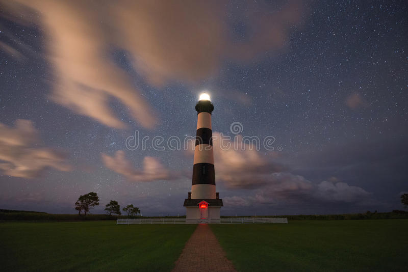 Bodie Lighthouse at night. A night shot of the Bodie Lighthouse under the stars with some clouds stock images