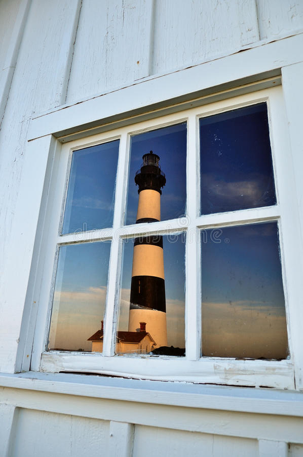 Bodie Lighthouse reflected in window stock photo