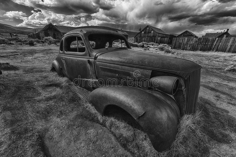 Bodie. Wreck of a ancient rusty car in a ghost town of Bodie. Bodie is a National Historic Landmark. It is located in Mono County, Sierra Nevada - California royalty free stock images