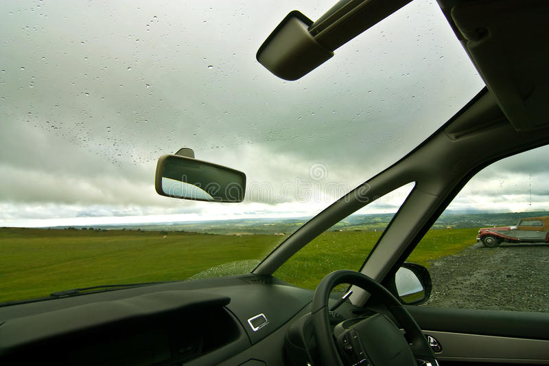 View from car. A view of Bodmin Moor from inside a parked car on a rainy day, in Cornwall, UK stock images