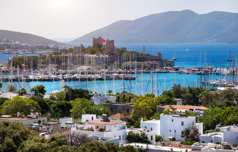 Bodrum castle and Aegean sea. View of Bodrum, Marina Harbor and ancient castle in Aegean sea in Turkey royalty free stock photo