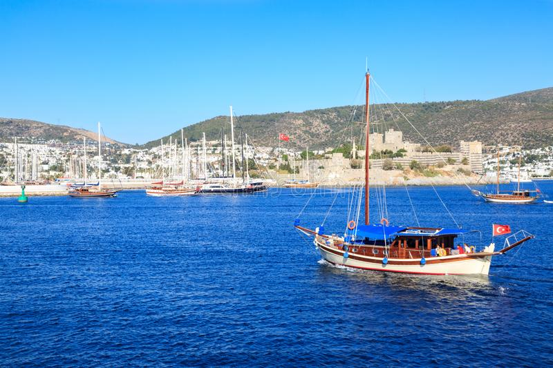 Bodrum castle from sea and boat in Bodrum. Turkey stock images