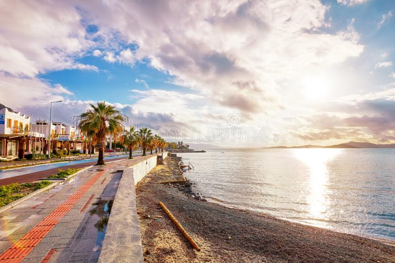 Beautiful winter sunset scene, the shore, street and sidewalk in Turgutreis, Bodrum, Mugla, Turkey stock photos