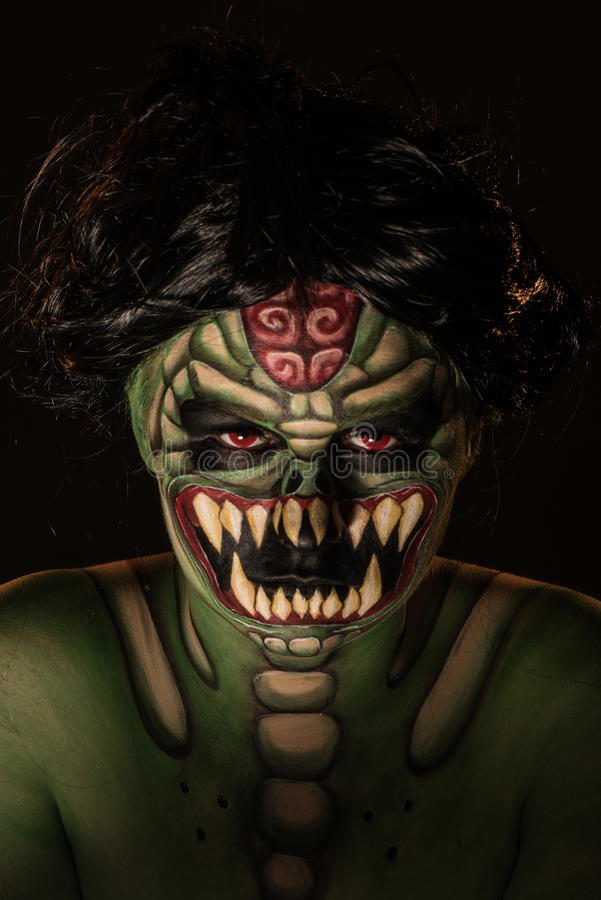 Body art of scary green monster royalty free stock photo